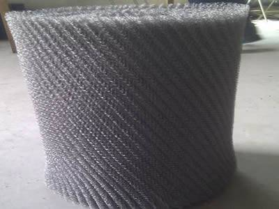 A roll of silver white SS 316 demister pad with grids.