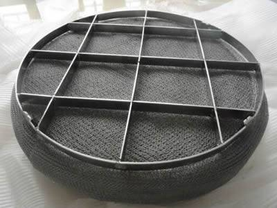 A piece of demister pad with grid on top. And the grid is divided into 16 sections.