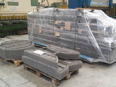 A pallet of packed demister pad with plastic film and several panels in bulk.