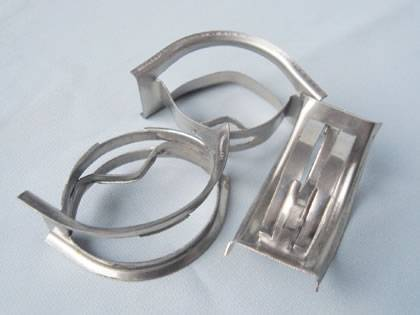 Three stainless steel Intalox Saddle ring on the gray background.