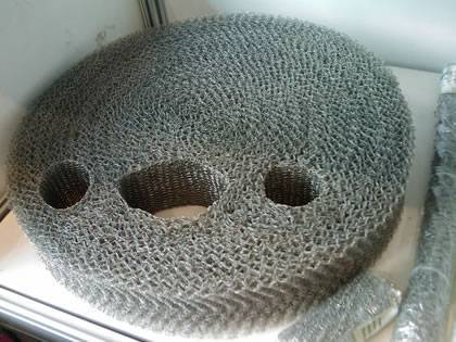 A round shape knitted mesh mister pad on the desk.