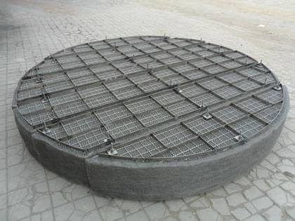 A drawer mister pad with supporting mesh and grating on the ground.