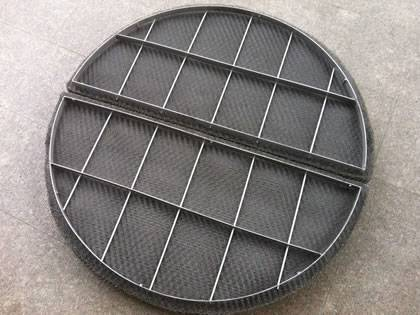 A piece of stainless steel mister pad with grating on the ground.