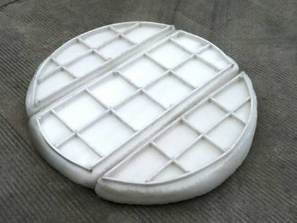 A piece of plastic mister pad with grating on the ground.