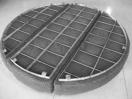 A drawer mister pad with round and flat bar grating.